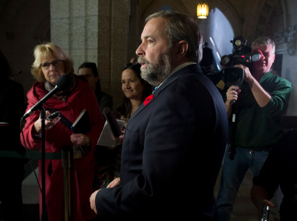 Tom Mulcair speaks with reporters