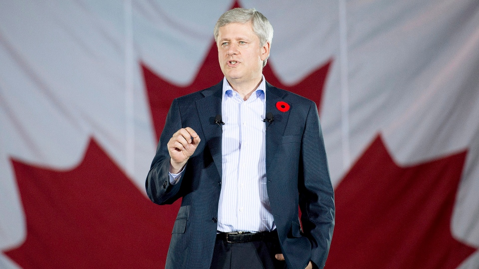 Prime Minister Stephen Harper announces tax cuts and increased benefits for families at a press conference at the Joseph and Wolf Lebovic Jewish Community Campus in Vaughan, Ont. on Thursday, October 30, 2014. (Nathan Denette / THE CANADIAN PRESS)