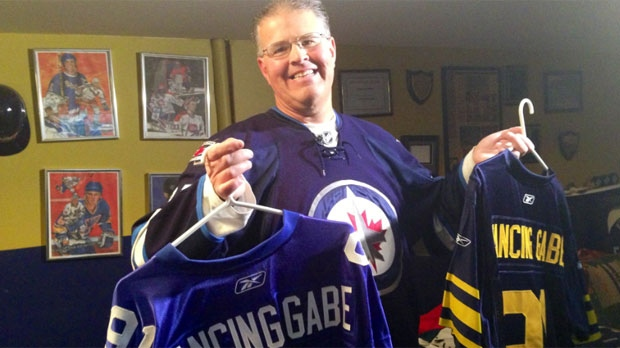 Dancing Gabe shows off some of his jerseys at his family's St. Vital home in Winnipeg.