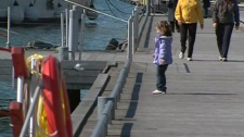 People are out enjoying the warm weather in Toronto, Wednesday, March 14, 2012.