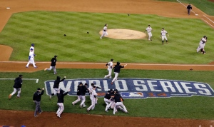 The San Francisco Giants celebrate after Game 7 of the World Series against the Kansas City Royals in Kansas City, Wednesday, Oct. 29, 2014. (AP / David J. Phillip)