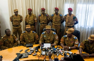 Burkina Faso's new interim leader Gen. Honore Nabere Traore, third from left in front, speaks during a press conference held in Ouagadougou, Burkina Faso, Friday, Oct. 31, 2014. (AP / Theo Renaut)