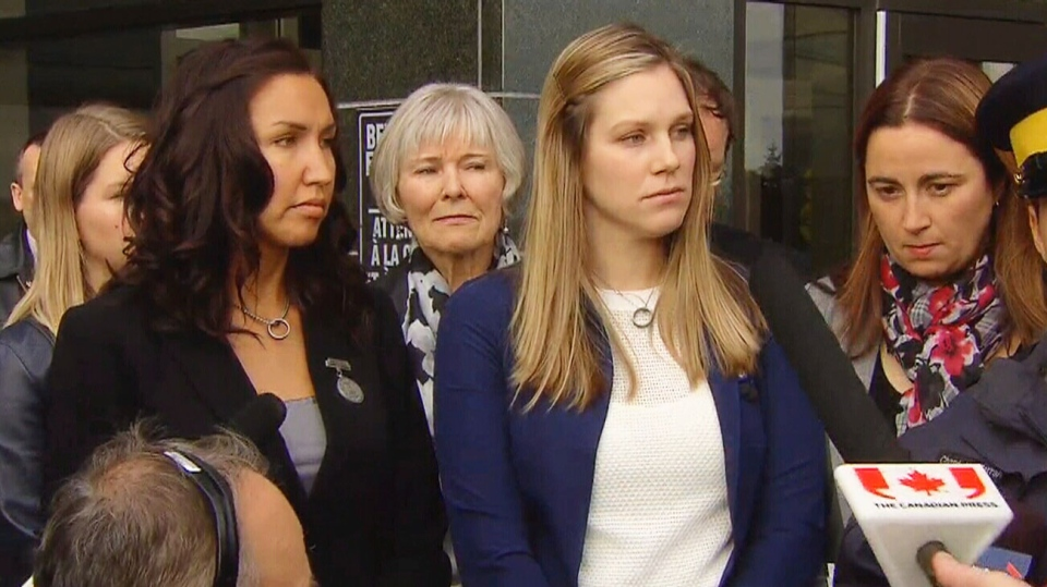 Widows of the slain Mounties react to the sentencing of Justin Bourque on Friday, Oct. 31, 2014.