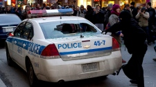 Demonstrators trash a police car during a march against police brutality Thursday, March 15, 2012 in Montreal. Protesters lobbed objects at officers, vandalized a few stores and smashed one police vehicle. Authorites responded by firing off chemical irritants in a bid to disperse a crowd of about 1,000 people. THE CANADIAN PRESS/Paul Chiasson
