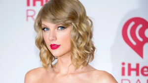TaylorSwift arrives at the iHeart Radio Music Festival in Las Vegas Sept. 19, 2014.  (Invision / Andrew Estey)