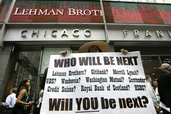 Robin Radaetz holds a sign in front of the Lehman Brothers headquarters Monday, Sept. 15, 2008 in New York. (AP / Mary Altaffer)