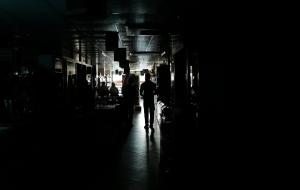 A Bangladeshi man walks in a shopping mall during a blackout in Dhaka, Bangladesh, Saturday, Nov. 1, 2014. (AP Photo/A.M. Ahad)