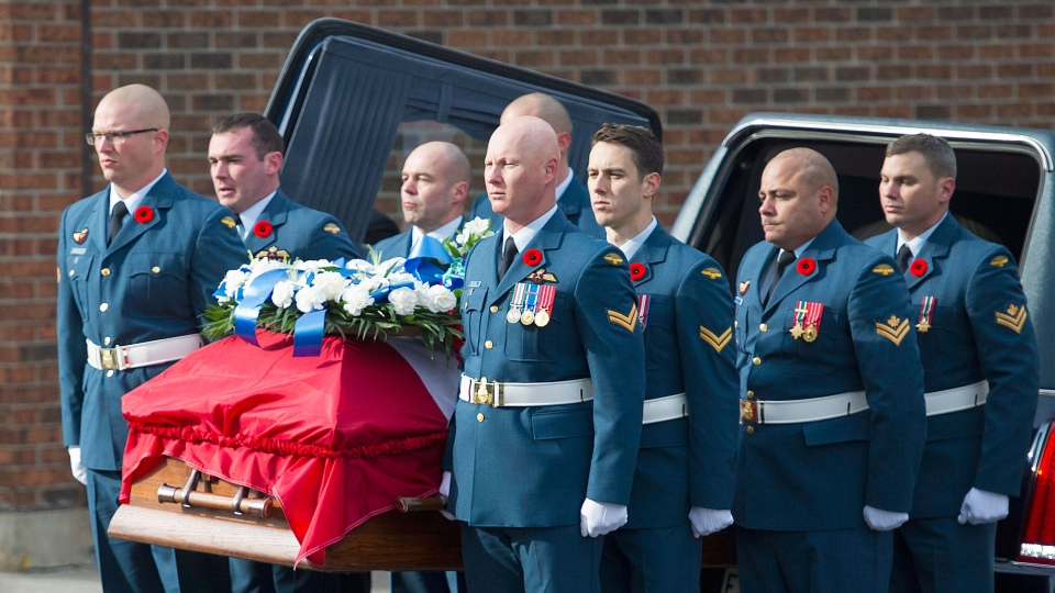 The casket containing the remains of warrant officer Patrice Vincent arrives for his funeral in Longueuil, Que., Saturday, November 1, 2014. (Graham Hughes  / THE CANADIAN PRESS)
