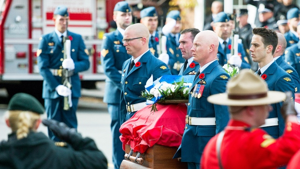 A private funeral for Warrant Officer Patrice Vincent, who was killed in the first of two violent attacks against Canadian soldiers last month, is held in Quebec Nov. 1, 2014. <br> <br> The casket containing the remains of warrant officer Patrice Vincent arrives for his funeral in Longueuil, Que., Saturday, November 1, 2014. (Graham Hughes / THE CANADIAN PRESS)