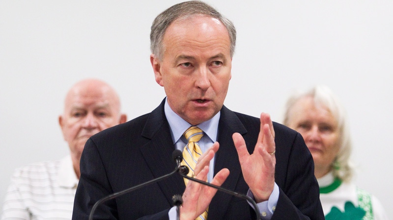 Minister of Justice Rob Nicholson gestures as he answers questions from members of the media following a press conference introducing legislation to help better protect senior citizens in Toronto on Thursday, March 15, 2012. (Pawel Dwulit  /THE CANADIAN PRESS)