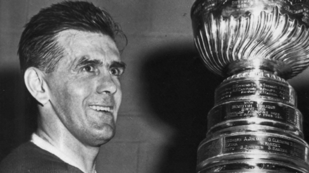 Maurice (Rocket) Richard poses with the Stanley Cup after beating the Bruins to win the league championship in Boston, Apr.20, 1958. (CP PHOTO/Files-AP)