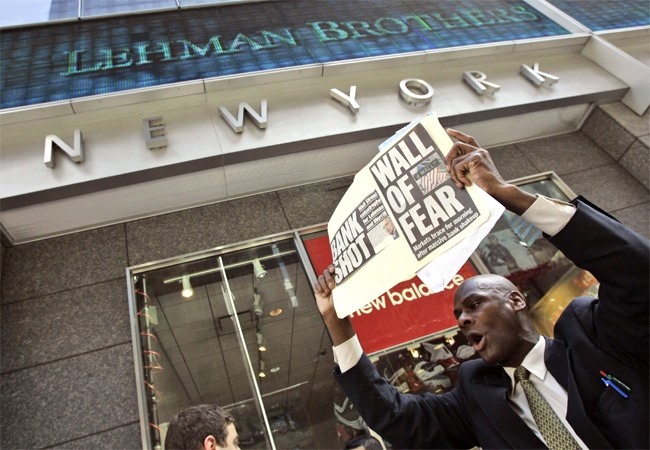 A man demonstrates outside the Lehman Brothers headquarters in New York, Monday, Sept. 15, 2008. (AP / Mary Altaffer)