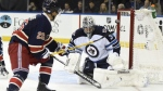 Winnipeg Jets goalie Ondrej Pavelec (31) blocks a shot by New York Rangers right wing Martin St. Louis (26) during the second period of an NHL hockey game at Madison Square Garden on Saturday, Nov. 1, 2014, in New York. (AP Photo/Kathy Kmonicek)