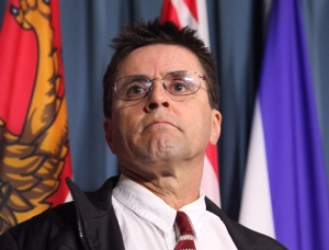 Hassan Diab listens to his lawyer speak at a press conference on Parliament Hill in Ottawa on Friday, April 13, 2012. (Patrick Doyle / THE CANADIAN PRESS)