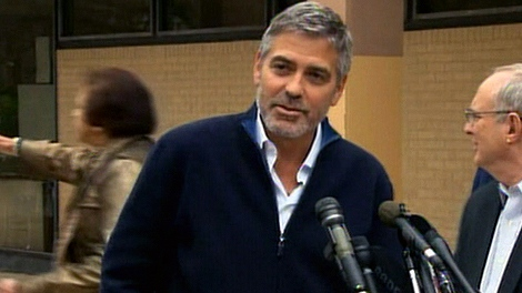 George Clooney speaks to reporters after being released from jail in Washington, Friday, March 16, 2012.