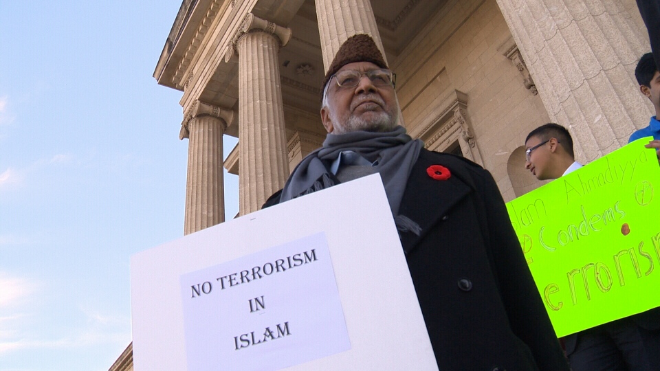 Muslims gather on the steps of the Manitoba Legislature Building to rally against the killing of Canadian soldiers on Sunday Nov. 2, 2014.