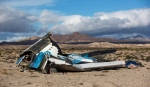 Wreckage lies near the site where a Virgin Galactic space tourism rocket, SpaceShipTwo, exploded and crashed in Mojave, Calif., Saturday, Nov 1, 2014. (AP / Ringo H.W. Chiu)