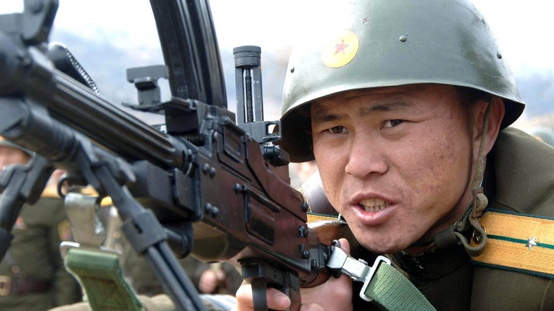 A North Korean soldier of a unit of the Korean People's Internal Security Forces takes a position during a live-fire exercise at an undisclosed place in North Korea, Thursday, March 8, 2012. (Korean Central News Agency via Korea News Service / AP )