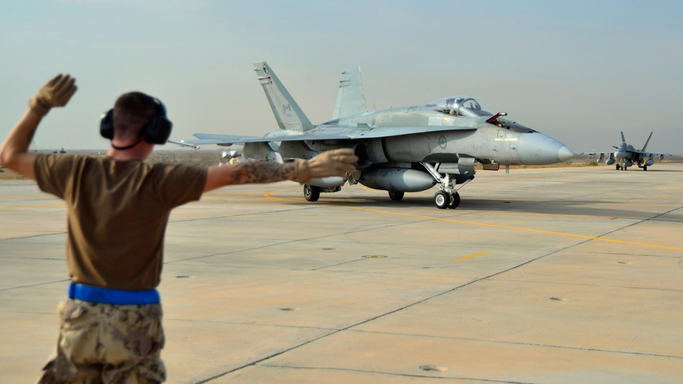 A Canadian Armed Forces CF-18 Fighter jet from 409 Squadron taxis after landing in Kuwait on Oct. 28, 2014. (THE CANADIAN PRESS / HO, DND-MND)