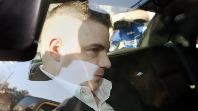 Michael Rafferty is transported from the courthouse in the back of police cruiser in London, Ontario, Wednesday, March, 14, 2012.  (Dave Chidley / THE CANADIAN PRESS)