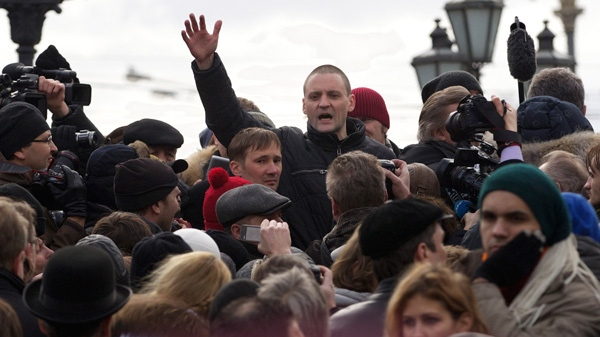 Opposition leader Sergei Udaltsov, center back, speaks at an unsanctioned rally at Pushkin Square in Moscow, Russia, Saturday, March 17, 2012. (AP / Ivan Sekretarev)