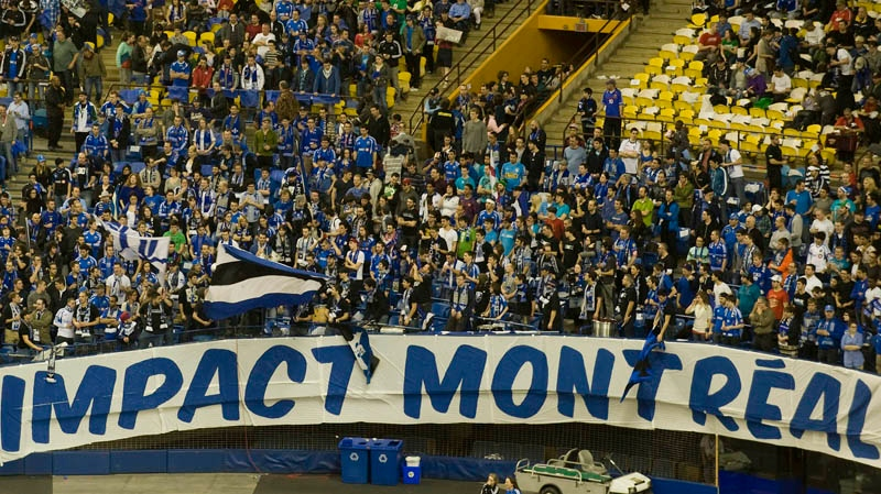 Montreal Impact soccer fans cheer on their team at the Olympic Stadium in Montreal, Saturday, March 17, 2012, ahead of the Impact's first home MLS game against the Chicago Fire. THE CANADIAN PRESS/Graham Hughes