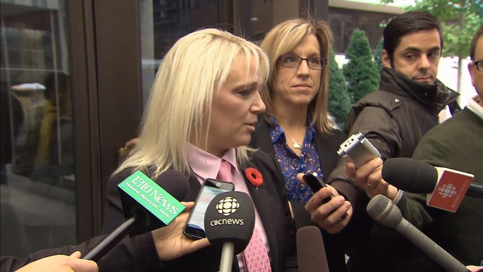 Ottawa Police Sgt. Kelly Lyle speaks to the media outside of a court house in Ottawa, Tuesday, Nov. 4, 2014.