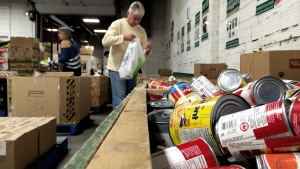 Volunteers sort food donations at the Saskatoon Food Bank and Learning Centre Tuesday, Nov. 4, 2014.