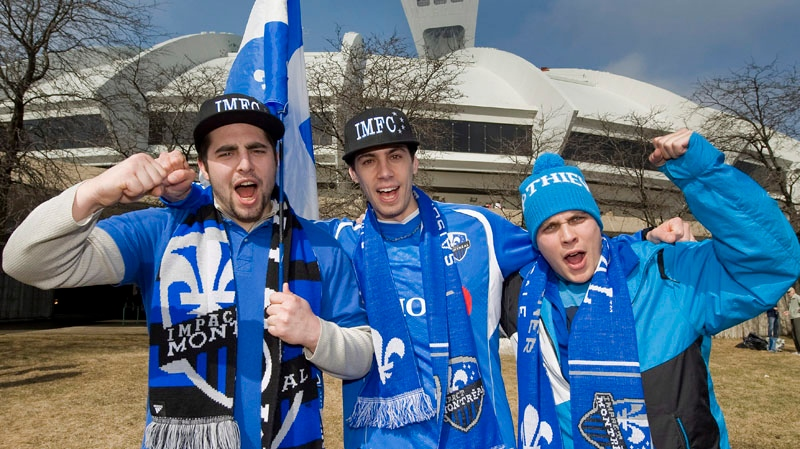 Montreal Impact soccer fans cheer on their team outside the Olympic Stadium in Montreal, Saturday, March 17, 2012, ahead of the Impact's first home MLS game against the Chicago Fire. THE CANADIAN PRESS/Graham Hughes