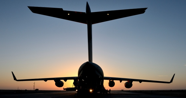 A Canadian Armed Forces CC-177 Globemaster aircraft waits to be unloaded after landing in Kuwait during Operation IMPACT on Nov. 3, 2014. (Canadian Forces Combat Camera / Department of National Defence)