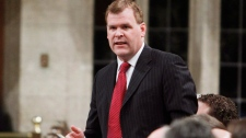 Foreign Affairs Minister John Baird stands in the House of Commons during Question Period, Friday March 16, 2012 in Ottawa.