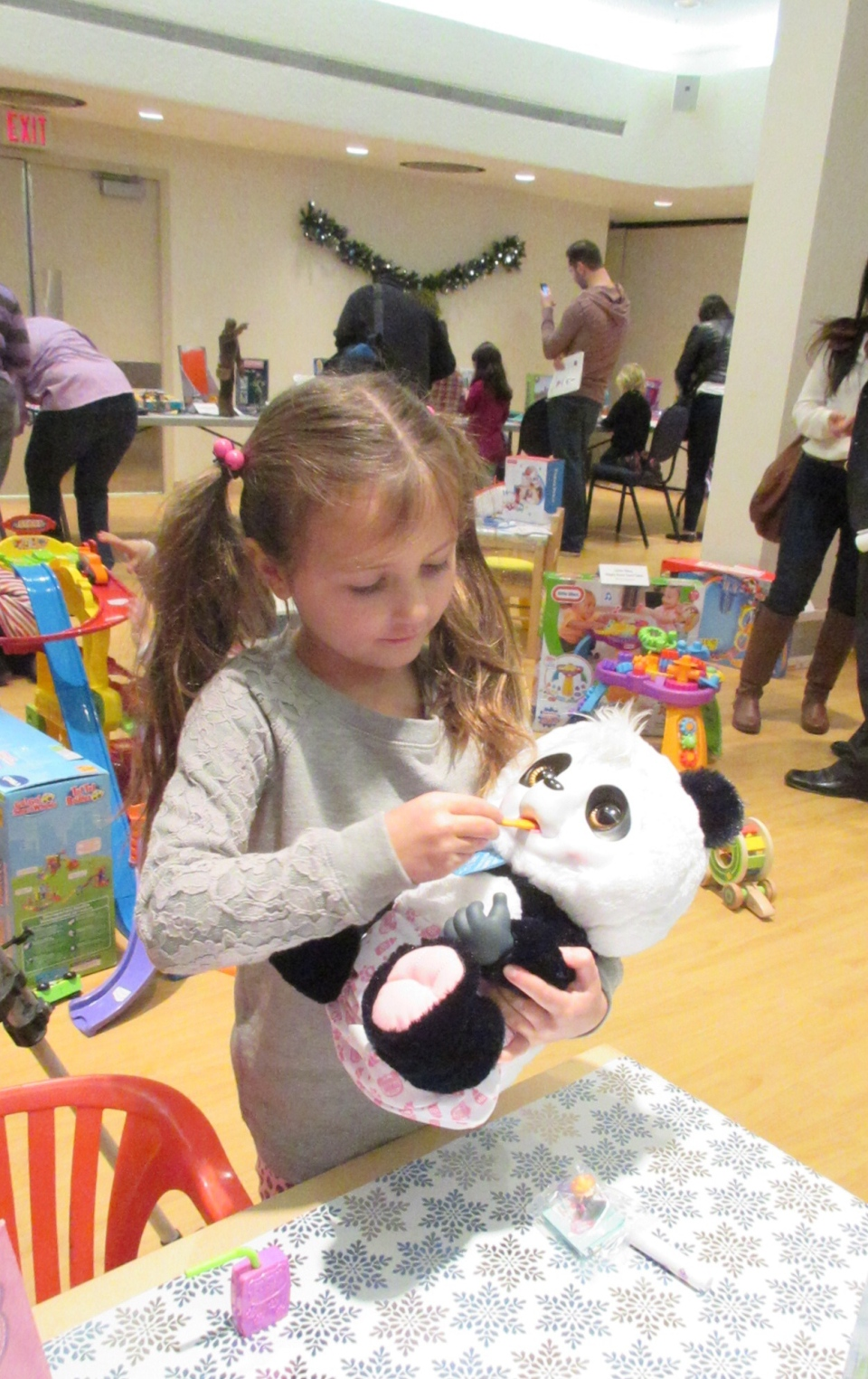 Hannah Ruscio, 6, plays with Animal Babies Crunchy Munchy Panda at a hottest toys showcase in downtown Toronto on Tuesday. Nov. 4, 2014. (Angela Mulholland / CTVNews.ca)