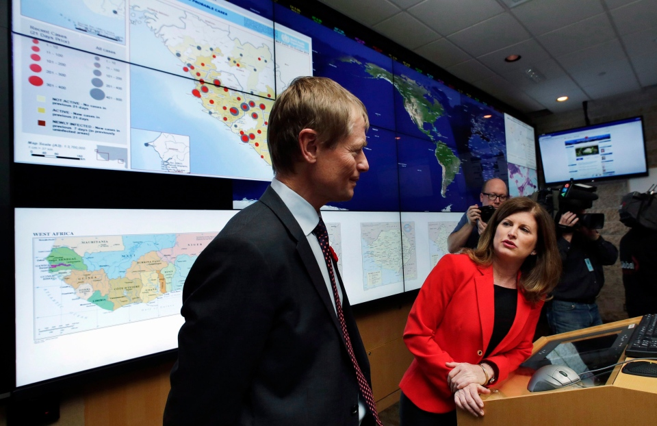 Canada's Federal Minister of Health Rona Ambrose speaks with with Dr. Gregory Taylor as she tours the Emergency Response Center at the National Microbiology Lab in Winnipeg on Nov. 3, 2014. (Lyle Stafford / THE CANADIAN PRESS)