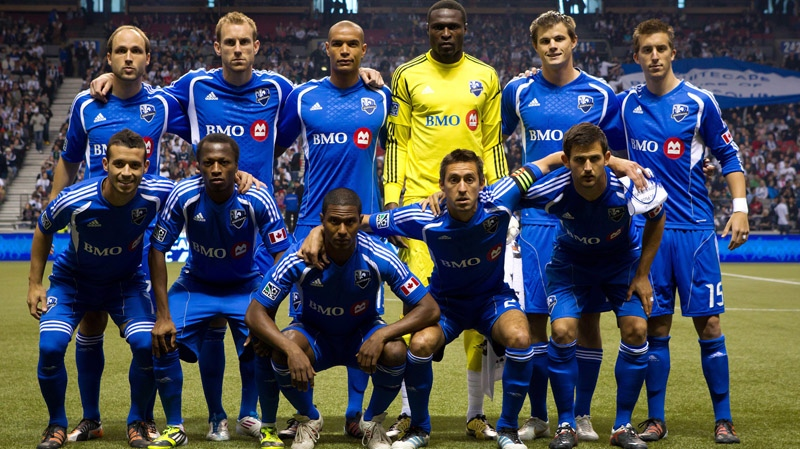 Montreal Impact's starting 11 players pose for a team photo before playing in their inaugural MLS soccer game against the Vancouver Whitecaps in Vancouver, B.C., on Saturday March 10, 2012. Pictured in the top row from left are, Justin Mapp, Tyson Wahl, Matteo Ferrari, goalkeeper Donovan Ricketts, Justin Braun and Jeb Brovsky and in the bottom row from left, Felipe Martins, Sanna Nyassi, Patrice Bernier, Davy Arnaud and Josh Gardner. THE CANADIAN PRESS/Darryl Dyck