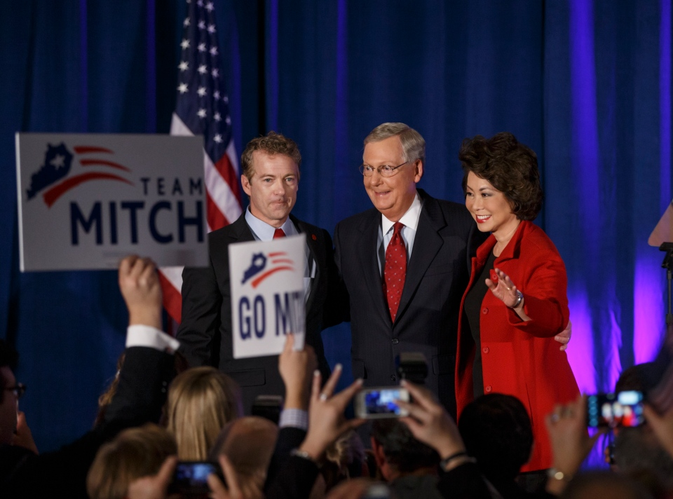 Senate Minority Leader Mitch McConnell, R-Ky., centre, celebrates with Sen. Rand Paul, R-Ky., left, and his wife, former Labor Secretary Elaine Chao, at an election night party in Louisville, Ky.,Tuesday, Nov. 4, 2014. (AP / J. Scott Applewhite)