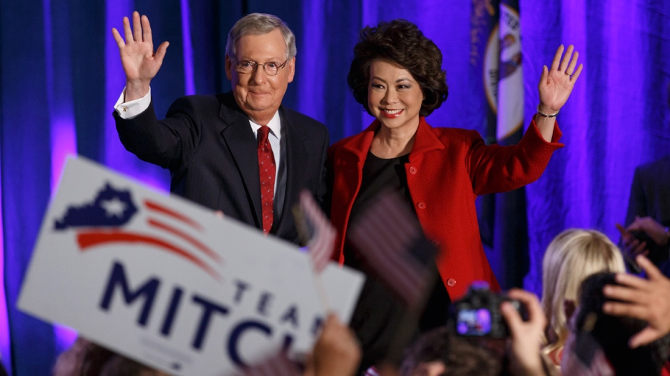 Senate Minority Leader Mitch McConnell of Ky., joined by his wife, former Labor Secretary Elaine Chao, celebrate in Louisville, Ky., Nov. 4, 2014. (AP / J. Scott Applewhite)