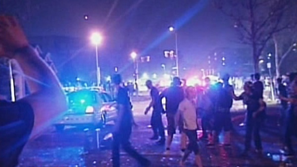 Dozens of city police officers faced off against a mob of St. Patrick's Day partiers who ignited several fires in London, Ont. in 2012.