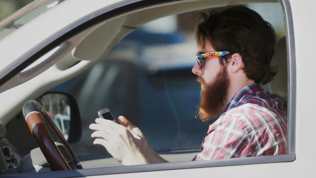A driver using his cell phone