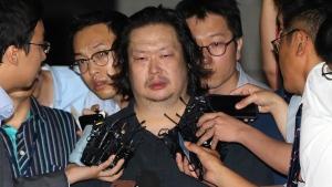 Yoo Dae-gyun, centre, arrives at Incheon District Prosecutors' Office in Incheon, South Korea, on July 25, 2014. (AP / Yonhap, Han Jong-chan)