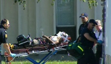 The shooting victim is transported to hospital by Toronto EMS after the incident at Bendale Business and Technical Institute in Scarborough on Tuesday, Sept. 15, 2008.