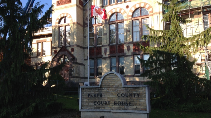 A flag flies at half-mast outside the Perth County Courthouse in Stratford, Ont., on Wednesday, Oct. 29, 2014. (Nicole Lampa / CTV Kitchener)
