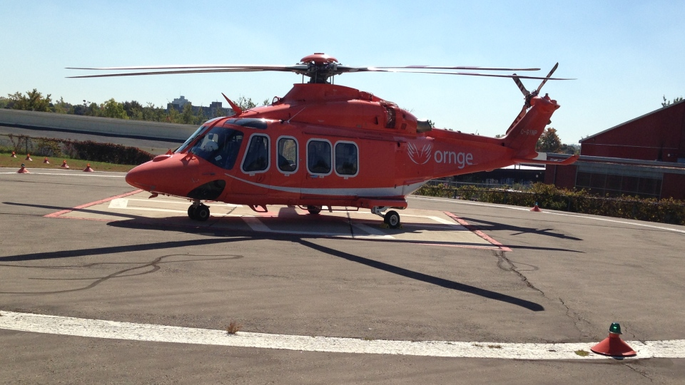An Ornge air ambulance sits on a helipad in Kitchener, Ont., on Friday, Oct. 17, 2014. (David Imrie / CTV Kitchener)