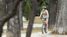 A cyclist rides a trail in Winnipeg Monday, March 19, 2012. Temperatures in the city were expected to hit 25C. (John Woods / THE CANADIAN PRESS)