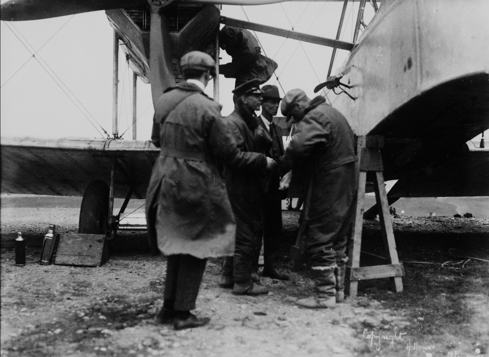 "Capt. John Alcock (centre) during loading of Vickers ""Vimy"" aircraft prior to trans-Atlantic flight, Lester's Field, St. John's, N.L., June 1919 (National Archives of Canada / THE CANADIAN PRESS / Holloway)"