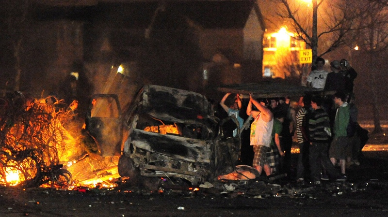 Rioters add more fuel to a fire during a riot in London, Ont., early Sunday, March 18, 2012. (Mike Maloney  / London Community News)
