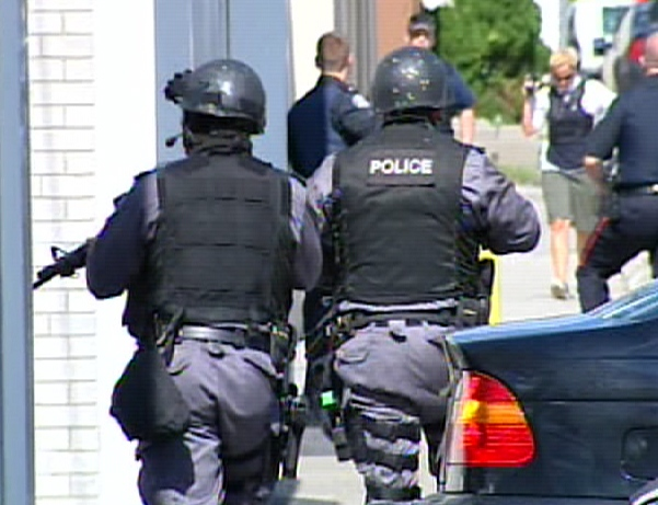 Toronto Emergency Task Force officers search for the suspect after a teen was found shot at Bendale Business and Technical Institute in Scarborough on Tuesday, Sept. 15, 2008.