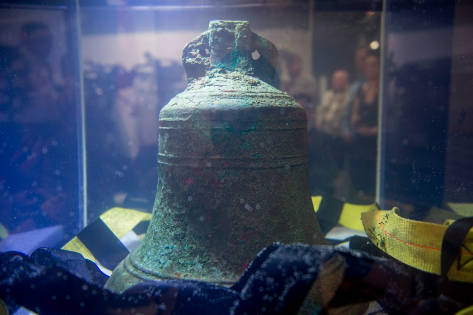 The ship's bell from the recently discovered Franklin Expedition shipwreck HMS Erebus sits in pure water after being recovered in Ottawa on Thursday, Nov. 6, 2014. (Justin Tang / THE CANADIAN PRESS)