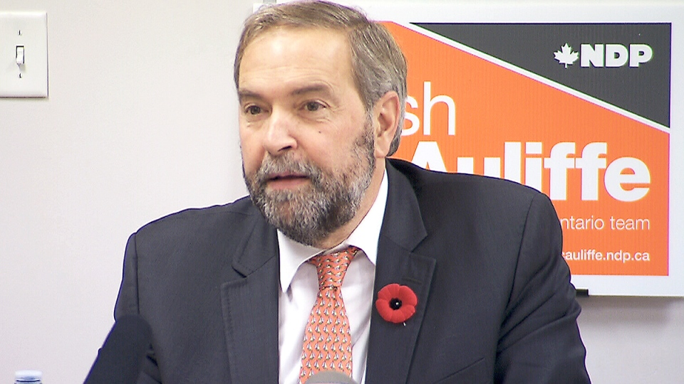 NDP Leader Tom Mulcair speaks to reporters at an event in Whitby, Ont., Thursday, Nov. 6, 2014.