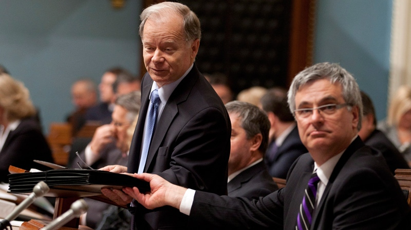 Quebec Finance Minister Raymond Bachand, left, tables the budget documents Tuesday, March 20, 2012 at the legislature in Quebec City.(Jacques Boissinot / THE CANADIAN PRESS)