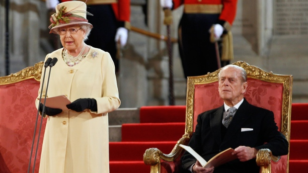 Queen Elizabeth II makes an address next to her husband The Duke of Edinburgh at Westminster Hall in London, Tuesday, March 20, 2012.(AP / Kirsty Wigglesworth)